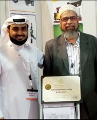 Al Dees (left) with Hussain