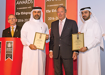 Faisal Faqeeh (second from left) and Abdulrahman Al Kooheji (right) with the awards