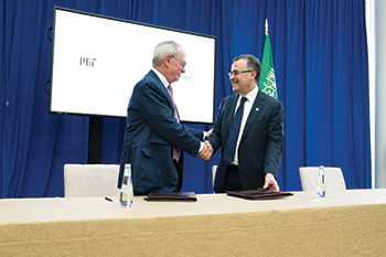 Nasser (right) and Reif shake hands after signing the agreement