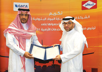 Engineer Azzam Qari, fuels director, APSCO, receives the licence