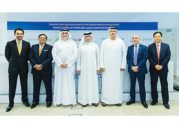 Masdar and Bee'ah officials ater achieving financial close