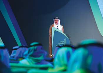 Nasser speaking at a forum