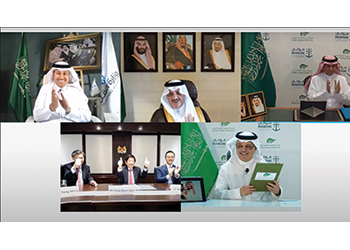 The agreement was signed under the patronage of Prince Saud, top centre