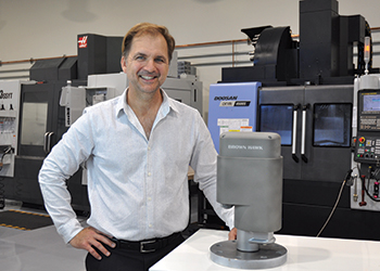 Brown poses with the BH-MPFM at the Brown Hawk manufacturing facility