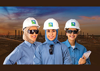 Aramco female workers in fire-resistant clothing ... safety first